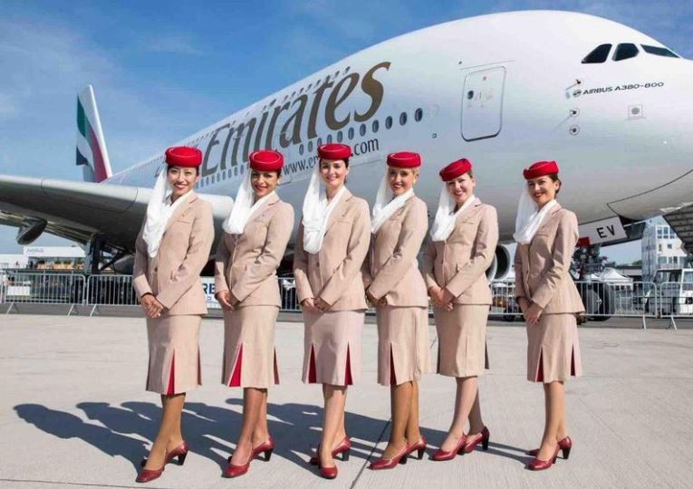 Emirates airline marketing strategy analysis A group of air host standing in front of Emirates Airplane